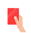 hand holding red football card vector image vector image