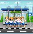 happy school kids at the bus stop vector image vector image