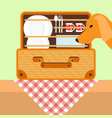 open basket for a picnic with tableware dog vector image vector image