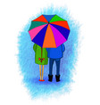 Young couple under the umbrella