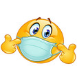 pointing at himself emoticon with medical mask vector image