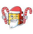 santa with candy rubik cube mascot cartoon vector image vector image