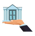 businesmann hand holding bank building vector image vector image