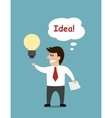 Smiling cartoon businessman with a light bulb vector image