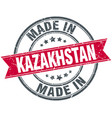 made in kazakhstan red round vintage stamp vector image vector image