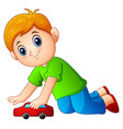 little boy playing a toy car vector image