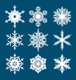set of white snowflakes isolated on blue vector image vector image