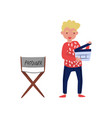 young smiling man with clapperboard guy standing vector image vector image