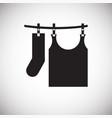 clothing hanging on rope icon on white background vector image