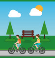 couple riding bicycle in park with bench tree sky vector image vector image
