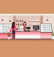 female barista coffee shop worker serving woman vector image vector image