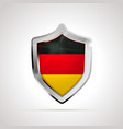 germany flag projected as a glossy shield on a vector image