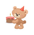 lovely teddy bear with party hat on head holding vector image