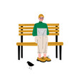 young man sitting on bench with laptop guy vector image vector image