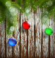 Christmas tree with decoration on a wooden surface vector image vector image