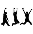 silhouettes of people jumping vector image vector image