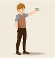 young man holding smartphones and taking selfie vector image