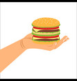 hand holding hamburger vector image