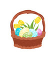 brown wicker basket full of painted eggs and tulip vector image vector image