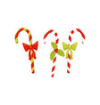 three candy canes decorated with bright bows and vector image
