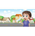 A boy holding a picture in front of the houses vector image vector image