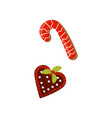 gingerbreads in shape of heart and candy cane vector image