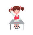 pupil girl raising hand for an answer at desk vector image vector image
