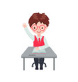 pupil boy raising hand for an answer at desk vector image vector image