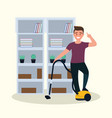young man uses vacuum cleaner in living room vector image vector image