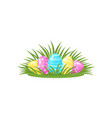 cute painted eggs hidden in the green grass vector image