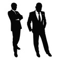 silhouette of a business man in a suit walking vector image vector image