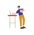 young man cooking in kitchen using laptop computer vector image vector image