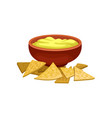 nnachos and cheese sauce in brown ceramic bowl vector image vector image