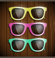 set of colored glasses on a wooden surface symbol vector image