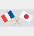 the crossed japan and france flags vector image