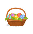 wicker basket full of painted eggs and green vector image vector image