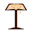 lectern with open bible and rosary vector image vector image