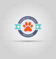 round label for veterinary clinic with dog paw vector image