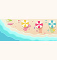 beach top view with umbrellas towels surfboards vector image vector image