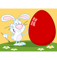 Happy Rabbit Painting Red Easter Egg Outdoors vector image