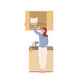 smiling modern housewife wash dishes at kitchen vector image