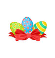 three painted easter eggs and big bright red bow vector image vector image