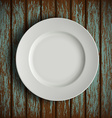 white plate on old wooden table vector image