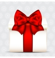 Gift box with red bow on christmas background vector image vector image