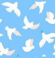 seamless pattern with doves on a blue background vector image