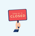 sorry we are closed sign in hand isolated on vector image