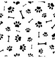 seamless pattern paw prints dogs vector image