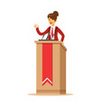 young politician woman speaking behind the podium vector image