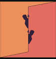two men peek out from behind the wall vector image