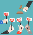hand hold bid sign and judge hammer auction vector image